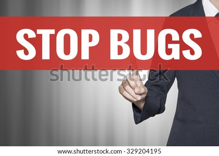 Stop Bugs word on virtual screen push by business woman red tab - stock photo