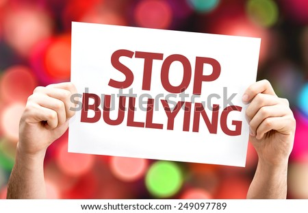 Stop Bullying card with colorful background with defocused lights - stock photo