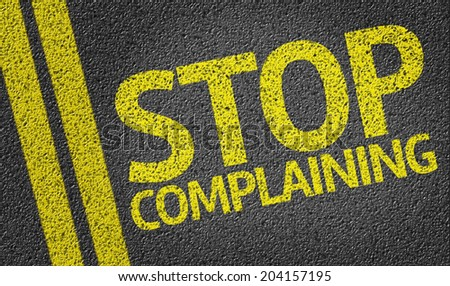 Stop Complaining written on the road - stock photo