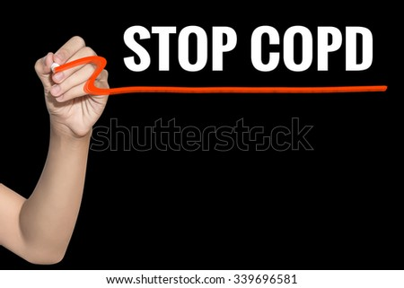 Stop COPD word write on black background by woman hand holding highlighter pen - stock photo