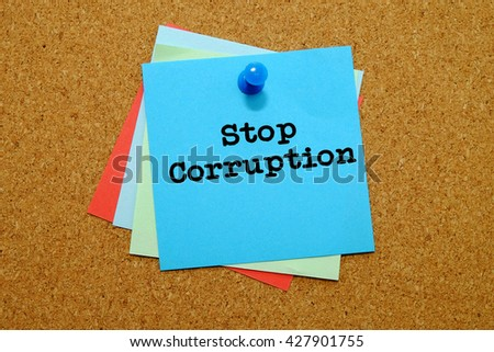 Stop Corruption written on colored sticker notes over cork board background. - stock photo