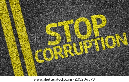 Stop Corruption written on the road - stock photo