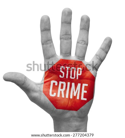Stop Crime Sign in Red Polygon on Pale Bare Hand. Isolated on White Background. - stock photo
