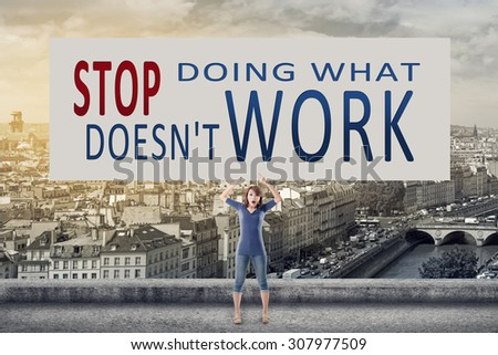 Stop doing what doesn't work, words on blank board hold by a young girl in the outdoor. - stock photo