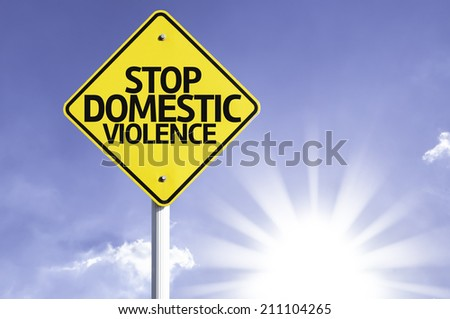 Stop Domestic Violence road sign with sun background  - stock photo