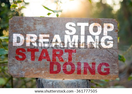 stop dreaming start doing text on old wooden - stock photo