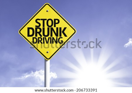 Stop Drunk Driving road sign with sun background  - stock photo