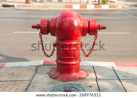 Stop fire with water hydrant, big water pump on street - stock photo