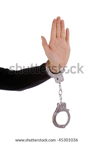 STOP - Hand of a young woman in handcuffs