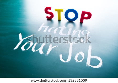 Stop hating your job concept, colorful words on blackboard - stock photo