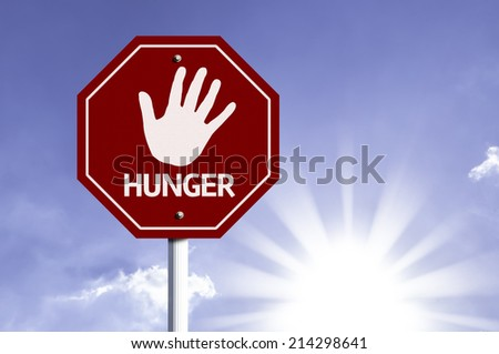 Stop Hunger red sign with sun background  - stock photo