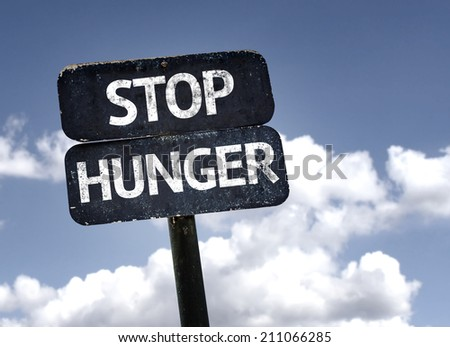 Stop Hunger sign with clouds and sky background  - stock photo