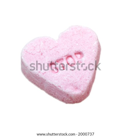 stop (in the name of love).  pink candy heat with the word 'stop' isolated on white.
