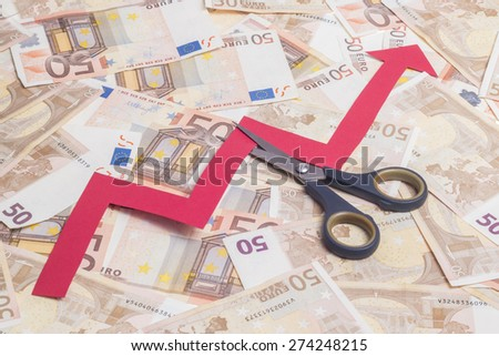Stop increasing euro value concept. Scissor cutting growing arrow over fifty euro notes background