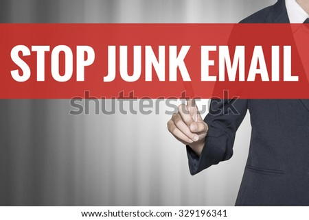 Stop Junk Email word on virtual screen push by business woman red tab - stock photo