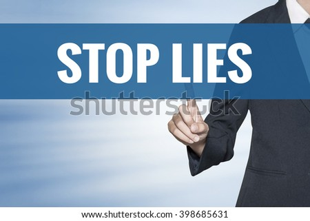 Stop Lies word on virtual screen touch by business woman blue background - stock photo