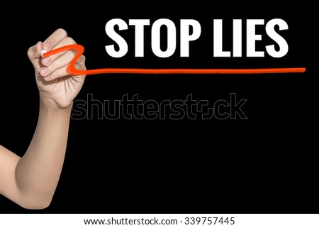 Stop Lies word write on black background by woman hand holding highlighter pen - stock photo
