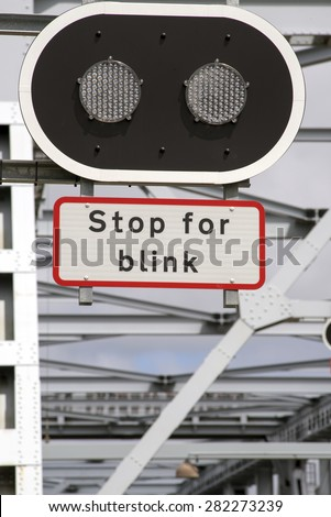Stop lights on The Old Littlebelt Bridge - Blurred bridge in the background. - stock photo