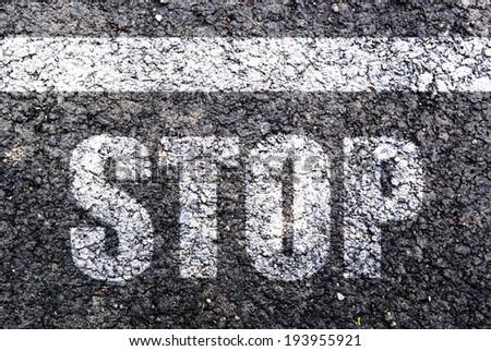 Stop,line on asphalt - stock photo