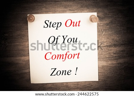 stop out of you comfort zone text concept on note paper  - stock photo