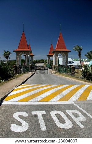 Stop painted on road before narrow one way bridge - stock photo