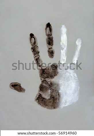 Stop racism ( Black and white hand on gray background )