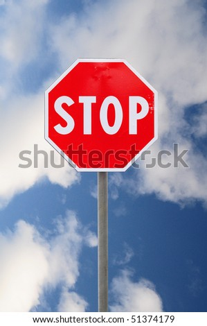 Stop road sign on cloudy sky - stock photo