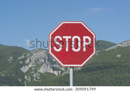 stop road sign on mountain background
