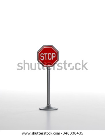 Stop road sign on white background  - stock photo