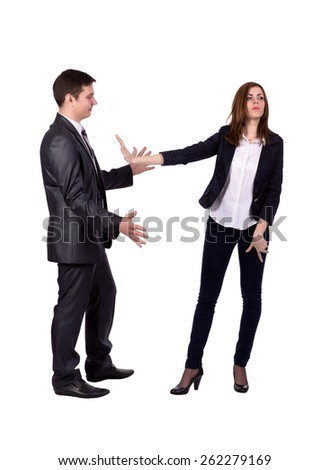 Stop sexual harassment! Image of two young adult people. Man attempts to harass lady, she expresses strong rejection gestures. Official dress code, white background, full body - stock photo