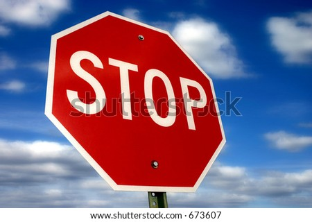 Stop sign against a beautiful sky - stock photo