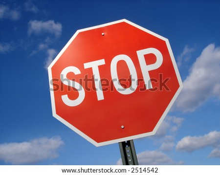 Stop sign against a blue sky. - stock photo