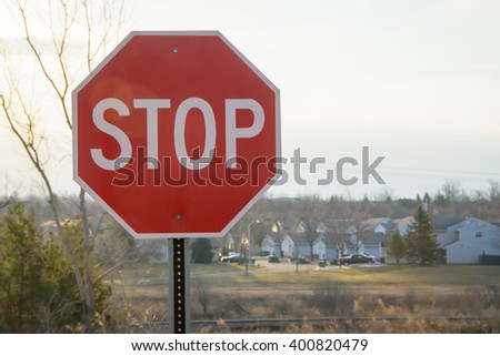 Stop sign against a blue sky - stock photo