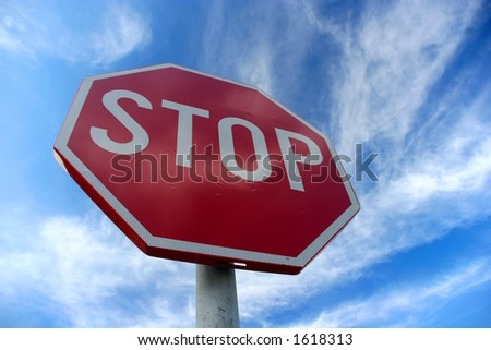 Stop sign against a cloudy sky