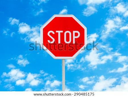 Stop sign against blue sky background  - stock photo