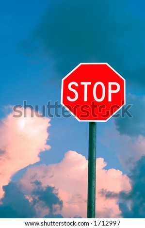 stop sign against clouds at sunset - stock photo