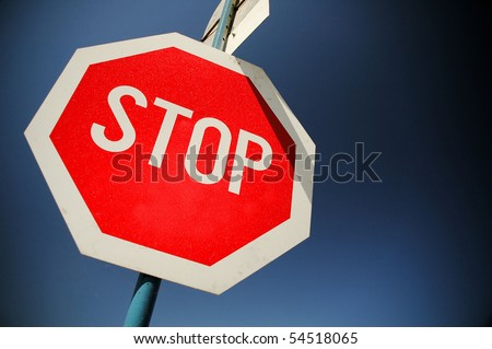 Stop sign and deep blue sky, warning sign concept - stock photo