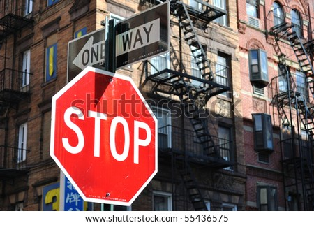Stop sign and one way sign in New York City. - stock photo