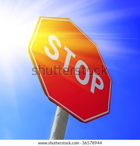 Stop sign and sun.