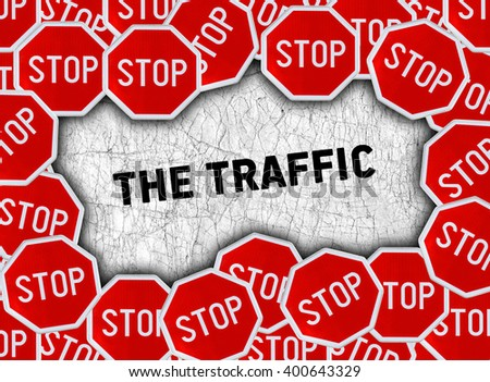 Stop sign and word the traffic - stock photo