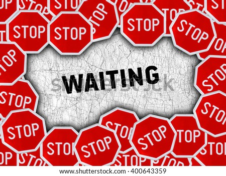 Stop sign and word waiting - stock photo