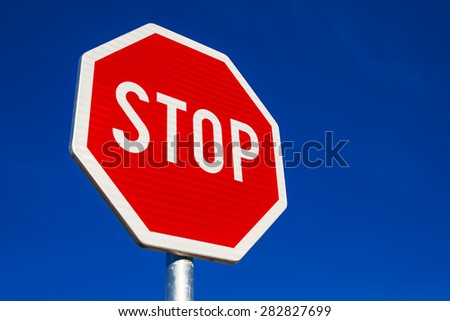 Stop Sign as Traffic Signalization over Blue Daylight Sky