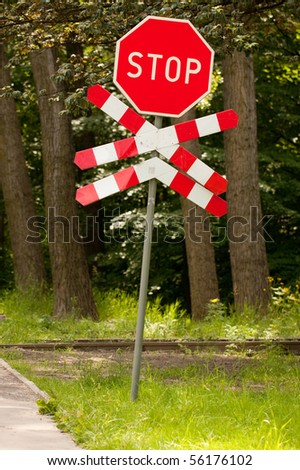 Stop sign at railway crossing - stock photo