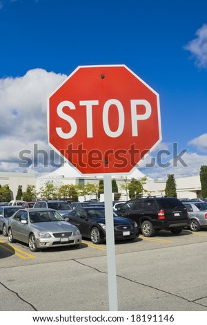 stop sign at shopping center parking