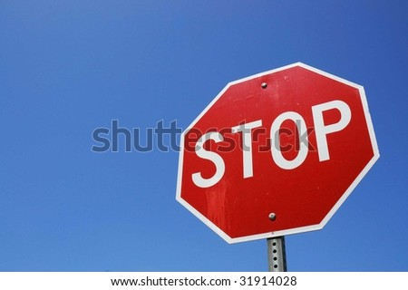 Stop sign blue sky background - stock photo