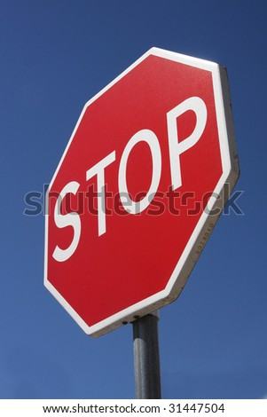 Stop Sign in a blue sky