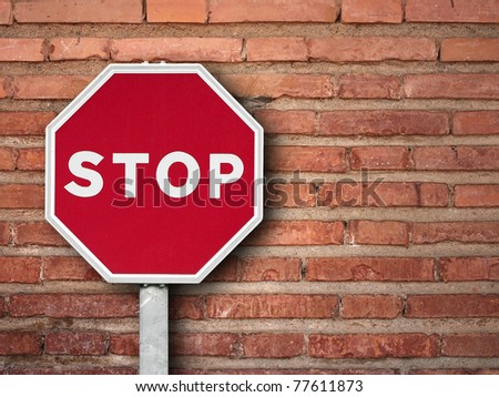 stop sign on a brick wall - stock photo