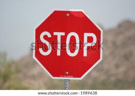 Stop sign on a desert road