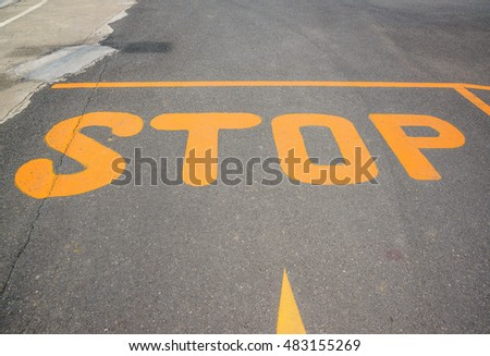 Stop sign on asphalt, Yellow Stop sign on the road.