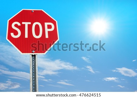 Stop sign on blue sky background